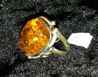Серебро  - Кольцо -  ажурная оправа. Янтарь цвет камня натуральный.